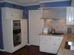 blue and white kitchen cabinet with oven