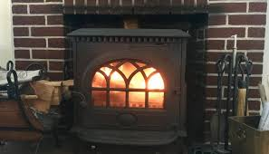 wood stove or fireplace fire in woodburning stove in hearth