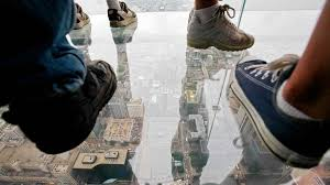 partints stand on the new glass balconies suspended 1 353 feet in the air and jut out