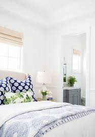 bedroom decorating ideas blue and green. white bedroom with blue patterned pillows and duvet rattan roman shades decorating ideas green m