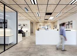 interior office space. workspaces arranged in u shapes play on wood back room blackwood street bunker by clare cousins architects shared office space melbourne interior g