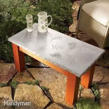 Once concrete is ready, pour a 4 inch layer into the bottom of another bucket Build Your Own Concrete Table Diy