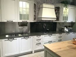 wallpaper on kitchen cabinet doors frosted glass cabinets door white island with wooden copper pots black