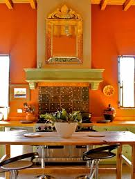 Mexican Kitchen With Orange Walls And Ornate Mirror Colorful And