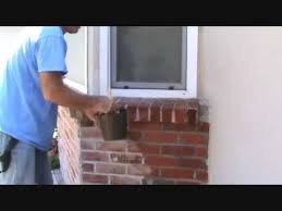how to apply sealer to a brick wall