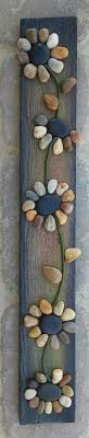 I could make something like this for our patio with all the pretty beach  pebbles I've been collecting! -Original pebble/rock art depicting a string  of ...