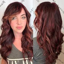 Women S Wavy Layered Cut With Vibrant Burgundy Color And Side
