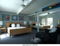 modern fitted bedroom furniture. Modern Fitted Bedroom Furniture Mirrored Doors On Wardrobes In With Pale Wood Bed