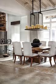 elegant white drum shade chandelier back to rustic texas home with modern design and luxury accents