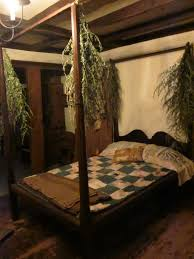 Swags of dried greenery hung from the canopy bed posts.   Primitive ...