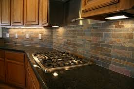 picturesque brown teak kitchen cabinet with subway slate backsplash added great black granite countertops and stove table in modern kitchen ideas