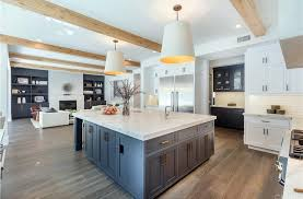 the kitchen features smooth marble countertop for both sink area and center island