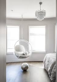 bedroom with acrylic bubble hanging chair