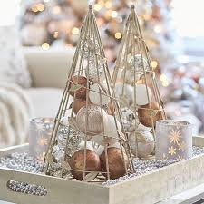 Decorative Wire Tray Wood tray filled with beads candles and decorative metal cone trees 36
