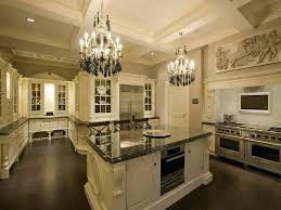 luxury white kitchen suspend chandeliers from ceiling spacious white kitchen with dark flooring and custom cabinetry