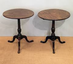 pair of antique tripod tables