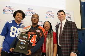 """Evan Engram of the NY Giants presents JFK Student Athlete Duane Coleman, II  with the """"Heart of a Giant"""" Award - John F. Kennedy"""
