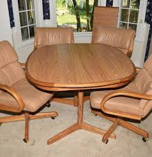Oak Kitchen Table And Four Leather And Oak Swivel Chairs