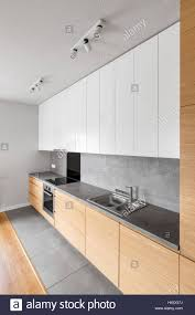 contemporary kitchen furniture with long grey countertop and