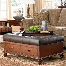 wood and brown leather ottoman coffee table