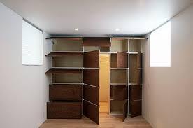 hidden door in wall. hidden door, drawers and shelves all visible when open door in wall