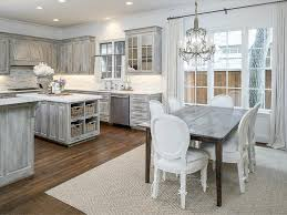 gray distressed kitchen cabinets with danby marble countertops