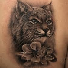 татуировка на боку парня рысь фото рисунки эскизы