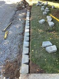 retaining walls around trees laying gray concrete retaining wall blocks in straight line by green grass retaining walls around trees