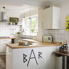 urban kitchen with white tiles and exposed bulb lights