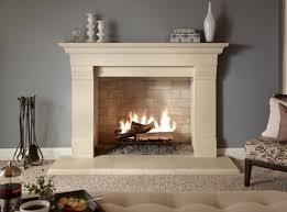 Interior. cream wooden Wooden Fireplace Mantel with cream hearth connected  by grey wall. Awesome