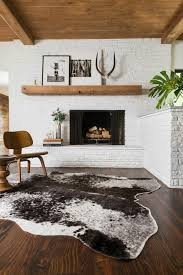 modern living room with brick fireplace. Rustic, Modern And Minimalist Living Room With An Eames Plywood Chair Cowhide Rug. Brick Fireplace L