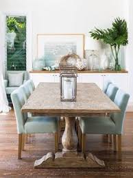 love the light blue furniture sea gl accessories and greenery that bring cool colors into the room full of warm wood tones