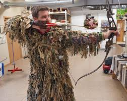 using the ghillie suit carry strap for keeping the chest area tight to the