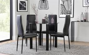 gallery solar round black glass dining table with 4 leon black chairs