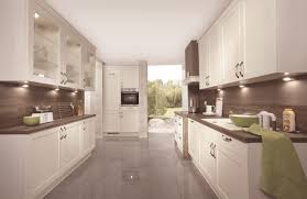 Ivory Kitchen Odina Nobilia Kitchen Ivory Cabinets Dark Wood Effect Laminate
