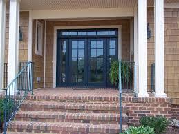 front french doorsTraditional Front Door with exterior brick floors  French doors