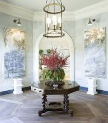 wonderful oconal entry foyer by phoebe howard love how the flooring imitates the shape of the room find this pin and more on dining chairs