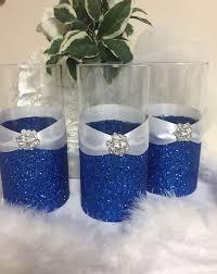 blue wedding decoration ideas. wedding centerpiece, glitter vase, bridal bouquet holder, bridesmaid bling wedding. royal blue weddingsblue themeswedding decoration ideas