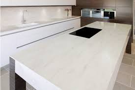 a corian island and benchtop with integrated sink and splashback by art of kitchens