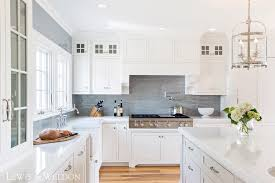 in the main kitchen area the subtle marble veining of pentalquartz in statuario moves through the perimeter countertops and island