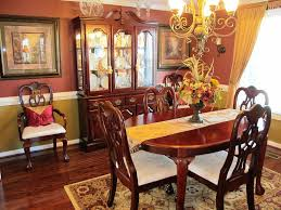 dining table parson chairs interior: oval dining table by broyhill furniture with table runner and parson dining chairs plus chandelier also
