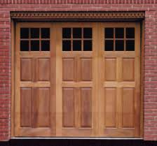 bi fold garage doorsArtisan Medallion Custom Wood Carriage House Garage Door by Jolicoeur