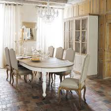 traditional dining room lighting fixture with crystal chandelier over oval wooden dining table and grey