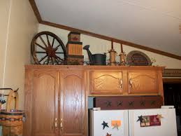 Kitchen Above Cabinet Decor Decorations For Above Kitchen Cabinets Gaudemus