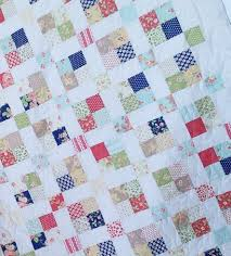 Sew Stormy & It's a little hard to tell, but I used wavy line quilting for this quilt. I  really like how it looks and how easy it was to quilt! Adamdwight.com