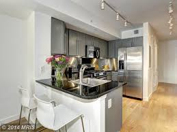 White Galaxy Granite Kitchen Craftsman Kitchen With Hardwood Floors Flush In Washington Dc