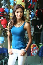 Erica Fernandes Showcasing Her Amazing Figure In a Blue Top and.