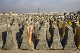 photo essay remnants of the trillion dollar war in  a stack of concrete barriers are stored in a yard after being removed during work to