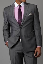 Daniel Craig's classic style for men, Gray suit and white shirt with purple  tie and pocket square.