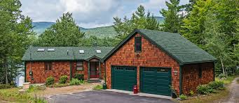 Residential garage door Bifold Residential Garage Door In Maine Hurricane Master Residential Garage Door Services In Maine Pdq Door